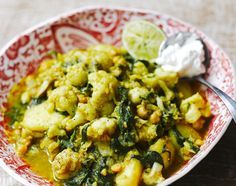 Jamie Oliver's Curried cauliflower, potatoes, chickpeas & spinach. We made this tonight and it's great and really fast.