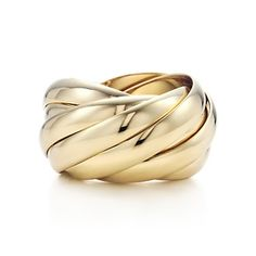 Paloma's Calife ring in 18k gold.    The nine individual bands glide together, separating and overlapping with silky movement.