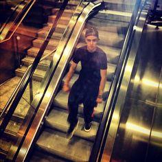 Liam on an escalator... he looks a bit... angry?!