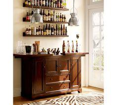 "Wet bar set-up. ""Holman Ledge"" shelving from Pottery Barn, $35-55."