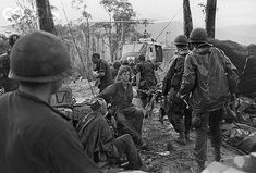 "24 May 1969, A Shau Valley, South Vietnam --- Wounded soldiers of the U.S. 101st Airborne Division are tended to and transported to a medical helicopter for evacuation following the battle for ""Hamburger Hill,"" an intense firefight against the Vietcong in the A Shau Valley. --- Image by © Bettmann/CORBIS"
