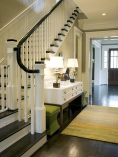 Idea for entrance hall. white walls. unit with lamp under stairs