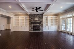 Beautiful Family Room with Hardwood Floors, Coffered Ceiling and Stone Fireplace
