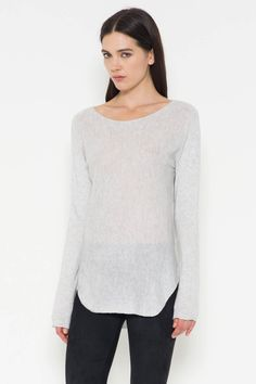 Essential basic long sleeve sweater. Slight Hi-Low with ribbing detail. Content + Care: 40% Polyester 25% Nylon 18% Wool 17% Acrylic Hand Wash
