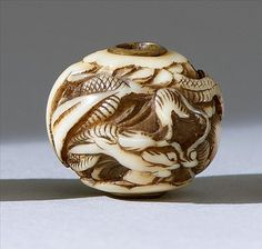 """IVORY OJIME In ball form with relief dragon design. Diameter .75"""" (1.8 cm)"""
