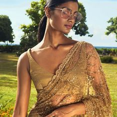Thinking of having designer sarees for your wedding? Think about the blouses as well. Here are a few of the best blouse designs for designer sarees from the collections of one of the most celebrated Indian Fashion designer Sabyasachi. Sabyasachi Lehenga Bridal, Bollywood Saree, Lehenga Choli, Net Saree, Bollywood Fashion, Desi Wedding, Wedding Looks, Saree Wedding, Maroon Wedding