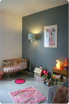 cute baby room with dark blue/grey wall