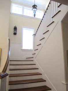 Paint and stain stairs hallway