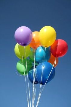 Colourful balloons dancing in a blue sky