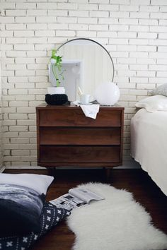 If you use a rectangular shaped dresser, contrast by using circular accessories on top! http://bit.ly/1fhneai