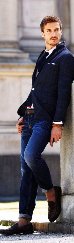 Shop this look on Lookastic:  https://lookastic.com/men/looks/blazer-dress-shirt-jeans-loafers-tie-pocket-square-belt-bracelet/13323  — White Dress Shirt  — Navy Knit Tie  — Navy and White Polka Dot Pocket Square  — Navy Vertical Striped Blazer  — Dark Brown Leather Belt  — Brown Bracelet  — Dark Brown Leather Loafers  — Navy Jeans