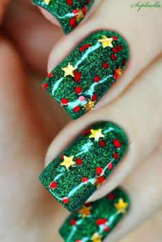 Christmas nail art - green glitter base, gold stars and red lights.
