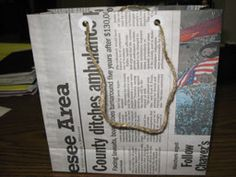 Newspaper bag with cardboard for reinforcements, great idea for gift bags!
