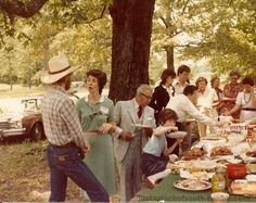 Dinner On The Grounds.  It is a particular variation of a potluck. Every member of the church brings a dish, and after the worship service we all stay for lunch. Notice the proliferation of fried chicken and ham.