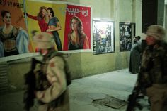 Yves Gellie - Baghdad, Iraq, 2003. US patrol. After the fall of Baghdad, a cinema was viewing erotic films which were immediatly suppressed following threats from radical Islamists.