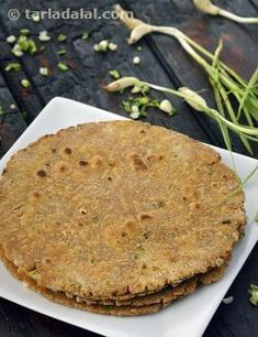 Whether a simple unleavened Chapati or a spongy leavened bread, garlic is always a great value-add. Here, we have made a delicious roti of multiple flours like wheat, jowar and bajra, fortified with oats, and flavoured with fresh green garlic and spice powders.