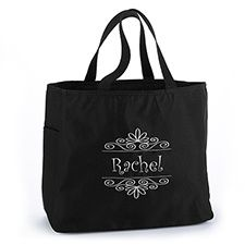 """Tote all those wedding must-haves with a flourish! This black canvas tote bag is embroidered with your monogram or name inside a flourish frame. Ideal bridesmaids gifts.  Product Details •Dimensions: 12"""" x 6 1/2"""" x 14"""" •Type of Printing: Embroidered •Price Includes: Personalized tote bag with black handles ZBK50367P"""