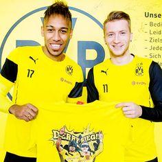Pierre-Emerick Aubameyang and Marco Reus posing with Batman & Robin Derbysieg T-shirt