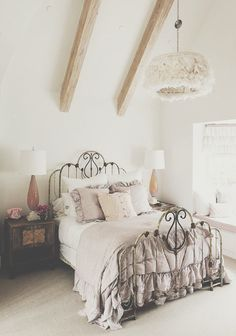 wrought iron bed + gray with antique. Wood dresser