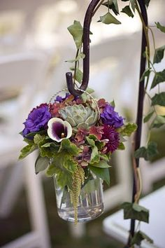 echevaria, lisianthus, cala lily etc to make a hanging jar of flowers