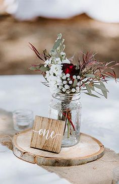 A Tropical Meets Rustic Wedding, wood wedding signs wedding table numbers, fall weddings, floral wedding decorations Christmas Wedding Centerpieces, Wedding Table Decorations, Wedding Themes, Rustic Wedding Tables, Christmas Wedding Flowers, Rustic Bohemian Wedding, Rustic Wedding Programs, Winter Centerpieces, Centerpiece Ideas