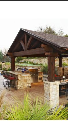separate building/gazebo type structure for outdoor kitchen adjacent to pool/house/yard