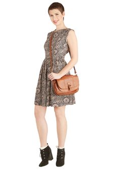 Merry to Carry Bag in Chestnut. Why is this chestnut-brown bag such a joy to bear? #brown #modcloth