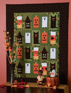 """Got scraps or fat quarters of Halloween fabrics? This boxy """"Boo!"""" quilt is the perfect place for them to hang out every October."""