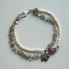 This chic garnet, labradorite and pearl bracelet adds a lustrous, becoming warmth to any look.