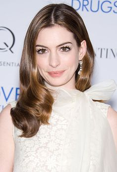 Brides.com: 25 Wedding Hairstyles Inspired by Celebrities. Anne Hathaway's Center Part Hairstyle. hairstyle ideas.
