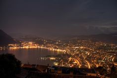 Lugano by night after a thunderstorm Lugano by night after a thunderstorm Lugano by night after a thunderstorm Picture taken from Monte Brè (Alsedago) Thunderstorm Pictures, Beautiful Scenery, Most Beautiful, Lugano, Thunderstorms, Hdr, Opera House, Night, Travel