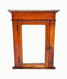 original and intact antique american victorian era varnished oak wood residential bathroom medicine cabinet with single hinged door.  circa 1891