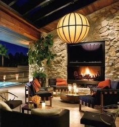 Love the huge stone fireplace and the light fixture.