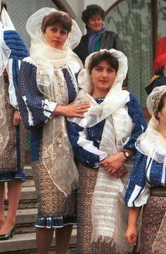 Romanian costume Domneşti - Argeş Silk marama worn with narrow beaded headband. Chemise with gathered neck (cămaşă încreţită), heavily embroidered with blue wool and silk thread.  Photo taken in village of Domneşti - Argeş in April 1999.