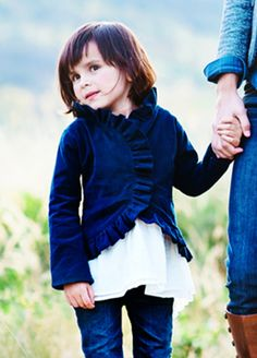 Lavalia in Navy - We love the darling, feminine shape of this ruffled little jacket.  It is nipped in at the waist, but swings low in the back for drama.  Made of fine wale navy corduroy to keep your little flowergirl warm during your winter wedding.