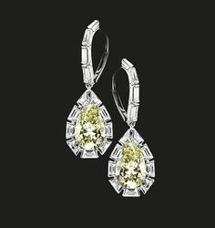 Pear Shaped Diamond Earrings   Twin pear shaped yellow diamonds surrounded by white baguette diamonds. Pear shaped yellow diamonds 8.07 cts