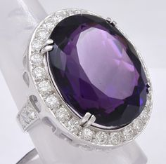 Grand Amethyst and Diamond Platinum Ring,   Very large and striking Amethyst Ring set in Platinum. The faceted Amethyst is 22 cts. and is Gem Quality. Surrounded by 2.25 cts. of full-cut Brilliant Diamonds. Circa 1950's This Ring is simply a Show Stopper.
