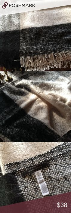 """Luxurious Black White Plaid Blanket Scarf NWOT Wrap yourself in luxury with this black white plaid blanket scarf, fringe detail by BCBG Maxazria. Length is 72"""", fringe on each end is additional 2"""",  width is 24"""". NWOT BCBGMaxAzria Accessories Scarves & Wraps"""