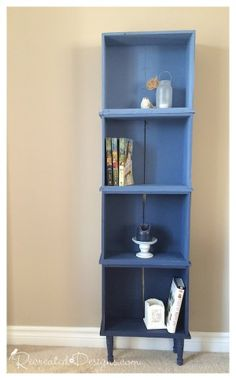 Leftover dresser drawers are repurposed into an ombre bookcase - by Recreated Designs