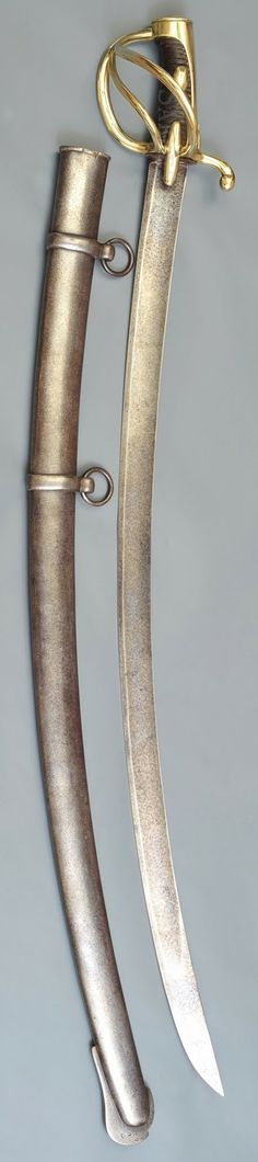 This sword was manufactured at Klingenthal. It has a leather-wrapped grip without twisted wire and two olive shape nuts to maintain the grip....an hungarian heritage from the previous Hussars swords!  Very heavy duty weapon for all Light cavalry, Hussars, Lancers, Horse Chasseurs.  Used during all Napoleon campaigns. Weights 2.53 kg with scabbard and 1.21 kg without.  The blade is 87 cm long and 3.7 cm wide