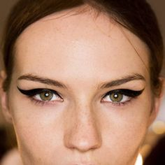 Bold flicky eyeliner looks so beautiful on a fresh, natural face with minimal cover (especially with freckles).