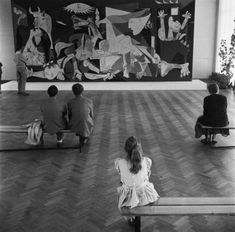 Pablo Picasso exhibition at the Stedelijk Museum, visitors look at the painting of Guernica (1956)
