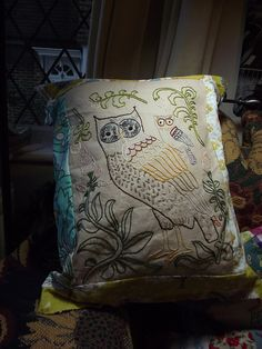 Embroidered owl pillow.