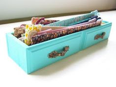 Painted drawers used as boxes. What a great idea !!