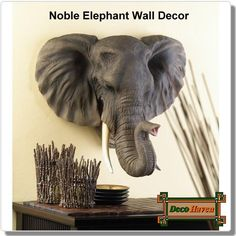 Noble Elephant Wall Decor - Indulge your wild side when you dress up a dull room with this lifelike sculptural plaque! Lovingly detailed re-creation of Nature's gentle giant is a breathtaking addition to any area.