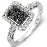 An exceptional look especially for her. A classic design, stunning in 10K white gold, this 0.55 ct. round cut enhanced Black diamond cluster center stones, with a clarity rating of SI, Bordering the stone, a rectangular frame set with shimmering white diamonds glitters brightly. Additional accent diamonds along the shank bring the total diamond weight to an awe-inspiring 0.55 ct. One of our finest and most popular Diamond Wedding Rings, you can't go wrong with this great piece.