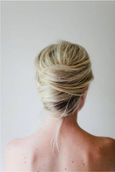 This gorgeous French twist from Irrelephant is the perfect hairstyle. Tightly curled updos are relics of proms past. #Prom #Hairstyles