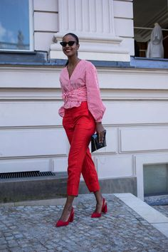 On the street at Berlin Fashion Week. Photo: Chiara Marina Grioni red pants with red pointy toe pumps and pink wrap shirt, pink top and red pants outfit Fashion Mode, Red Fashion, Look Fashion, Fashion Outfits, Womens Fashion, Fashion Trends, Red Pants Fashion, Street Fashion, Feminine Fashion
