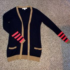 Navy cardigan, never worn New without tags, this navy cardigan from forever21 features orange stripes by the sleeves, and two small pockets in the front. Forever 21 Sweaters Cardigans