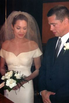 Angelina Jolie and Brad Pitt were married in this scene in Mr and Mrs Smith and now have tied the knot for real. [Angelina Jolie and Brad Pitt's Secret Wedding in France on Movie Wedding Dresses, Wedding Dress Costume, Celebrity Wedding Dresses, Wedding Movies, Wedding Scene, Star Wedding, Celebrity Weddings, Wedding Attire, Celebrity News
